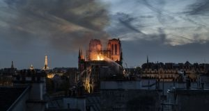 Flames and smoke are seen billowing from the roof at Notre-Dame on April 15th, 2019 in Paris, France. Photograph: Veronique de Viguerie/Getty Images