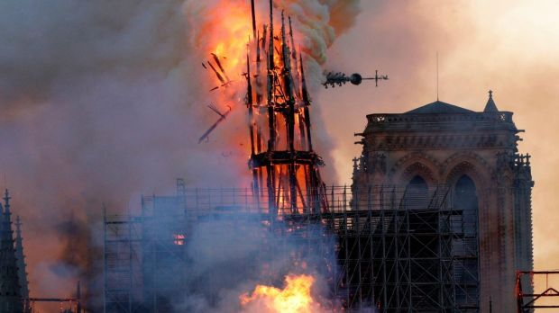 The steeple collapses as smoke and flames engulf the Notre Dame Cathedral in Paris. Photograph: Getty