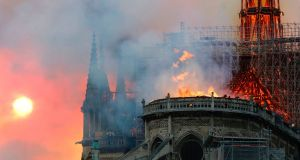 Smoke billows as flames destroy the roof of the landmark Notre Dame cathedral in central Paris. Photograph: FRANCOIS GUILLOT/AFP/Getty Images