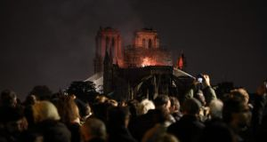 People watch as Notre Dame burns late into the night on April 15th, 2019. Photograph: Ludovic Marin/AFP/Getty Images