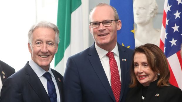 US House of Representatives speaker Nancy Pelosi (right) and Congressman Richard Neal (left) are greeted by the Tánaiste Simon Coveney, at Iveagh House, Dublin: Niall Carson/PA