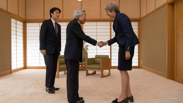 Britain's prime minister Theresa May (R) is greeted by Emperor Akihito of Japan during her visit to the Royal Palace. Photograph: Carl Court/Getty