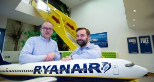 Boxever chief executive and co-founder Dave O'Flanagan, left,  and Ryanair's chief technology officer  John Hurley at the signing of their five-year deal . Photograph: Tom Honan for The Irish Times.
