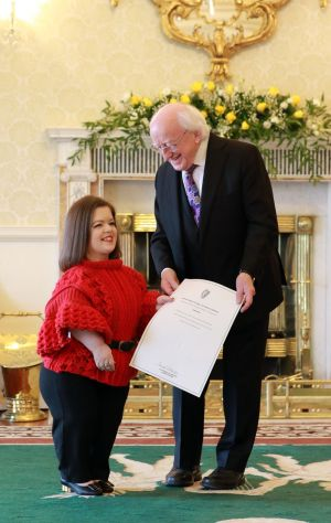 WARRANT OF APPOINTMENT: Sinead Burke receives a warrant of appointment to the Council of State from President Michael D Higgins at a ceremony at Aras an Uachtarain. Photograph: Nick Bradshaw