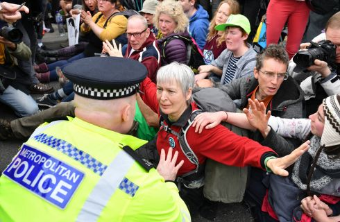 SITTING REBELS: A London police officer speaks to an environmental protester as police remove people from a blockade on Waterloo Bridge during the second day of a co-ordinated protest by the Extinction Rebellion group. Photograph: Leon Neal/Getty Images