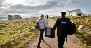A ballot box for Gola Island, off the west coast of Donegal, is brought to the polling station on the island ahead of the 2016 general election. Photograph: Alan Betson/The Irish Times