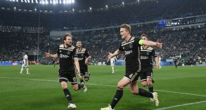 Ajax's Matthijs de Ligt celebrates scoring their second goal with Daley Blind and team-mates during the  Champions League quarter-final second leg against Juventus  at the  Allianz Stadium in Turin. Photograph: Alberto Lingria/Reuters