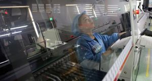 An employee working on the production line of an electronics factory in Jiaxing, Zhejiang province. Photograph: Reuters