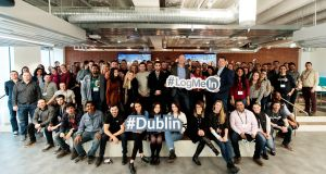 LogMeIn opened its new offices in the Reflector Building on Wednesday with help from Marc van Zadelhoff, chief operating officer, and Chris Manton-Jones, SVP & general manager, international business
