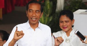 Indonesian president Joko Widodo and first lady Iriana Joko Widodo show their ink-stained fingers after casting their ballots  in Jakarta on Wednesday. Photograph: Edgar Su/Reuters