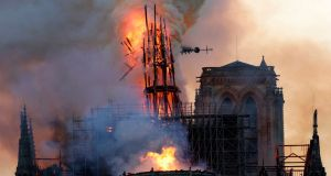 The steeple of Notre Dame collapses as smoke and flames engulf the cathedral in Paris, France. Photograph: Geoffroy Van Der Hasselt/AFP/Getty Images