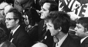 In defiance of a goverment ban on the 1976 Sinn Féin Easter parade, Labour TD David Thornley sat on the main stage outside the GPO alongside senior members of the republican movement Ruairí Ó Brádaigh and Dáithí Ó Conaill. Photograph: Pat Langan