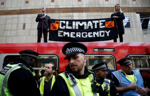 Policing during the Extinction Rebellion protest in London, Britain. Photograph: Henry Nicholls/Reuters