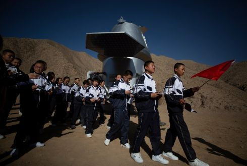Chinese students look at a replica of the Mars Lander as part of a tour of the C-Space Project, a Mars simulation base in the Gobi Desert in Jinchang, Gansu Province, China. Photograph: How Hwee Young/EPA