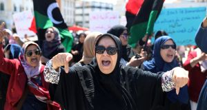 Libyan women shout slogans during a demonstration to demand an end to  Khalifa Haftar's offensive against Tripoli, at Martyrs' Square in the capital on Wednesday. Photograph: Hani Amara/Reuters