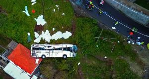 A video grab obtained from drone footage shows the wreckage of a tourist bus that crashed on April 17, 2019 in Canico, on the Portuguese island of Madeira.  Photograph: AFP/Getty Images