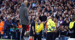 Referee Cuneyt Cakir consults VAR as Manchester City manager Pep Guardiola looks on during the Champions League semi-final against Tottenham Hotspur. Photo: Martin Rickett/PA Wire