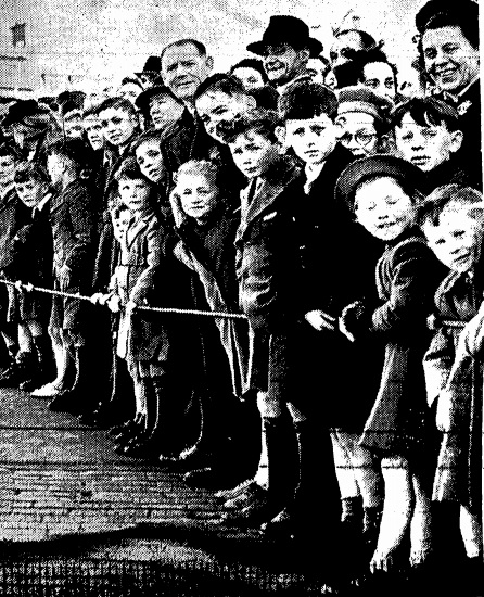 Times PictorIal, April 23rd: 'Young Ireland watches with eagerness and enthusiasm as the vanguard of the parade swings into O'Connell Street.
