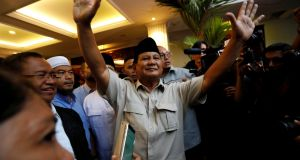 Indonesian presidential candidate Prabowo Subianto waves to the media after declaring himself the winner in Jakarta on Thursday. Photograph:  Willy Kurniawan/Reuters