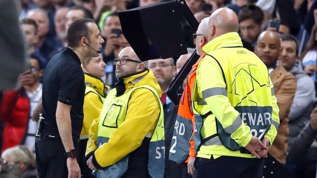 Referee Cüneyt Çakir consults VAR before allowing Fernando Llorente's goal to stand, putting Tottenham Hotspur back in front on aggregate against Manchester City. Photograph: Martin Rickett/PA Wire