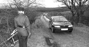 The hearse leaving the scene at Killygreen, Belcoo, Co Fermanagh, following the discovery of the remains of sex abuser David Sullivan in 2001. Photograph: John McVitty/Impartial Reporter