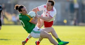 Meath's Cillian O'Sullivan tussles with Tyrone's Colm Cavanagh during last year's  All-Ireland qualifier at Páirc Tailteann. Meath came very close to dumping out the eventual All-Ireland finalists.  Photograph: Morgan Treacy/Inpho