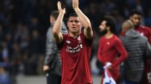Liverpool midfielder James Milner celebrates after  the  Champions League defeat of Porto in Portugal. Photograph: Paul Ellis/AFP/Getty Images