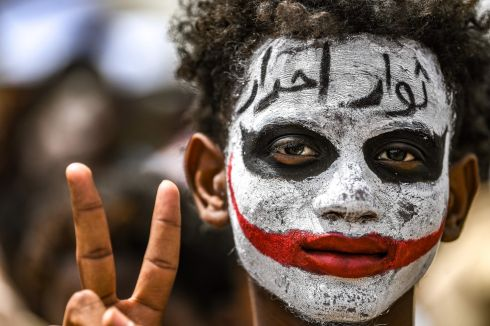 SUDAN UNREST: A Sudanese protester flashes a victory sign outside the army complex in the capital Khartoum. Photograph: Ozan Kose/AFP/Getty Images