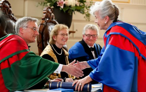 HONOURS DEGREE: Visual arts patron Carmel Naughton is presented with an honorary degree at a ceremony in Trinity College. Photograph: Maxwellphotography.ie