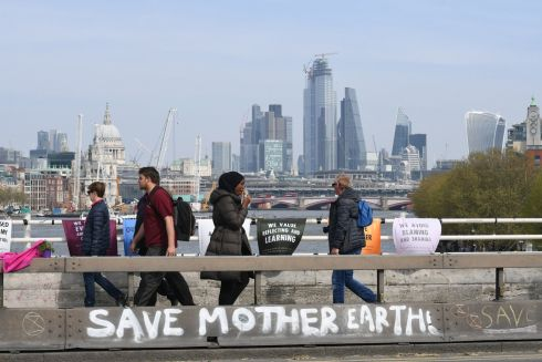 CLIMATE PROTESTS: People pass by the Extinction Rebellion demonstration on Waterloo Bridge, London. Photograph: Stefan Rousseau/PA Wire