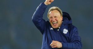 Neil Warnock celebrates following Cardiff City's crucial away Premier League win over Brighton which gives them a chance of avoiding relegation.  Photograph: Eddie Keogh/Reuters