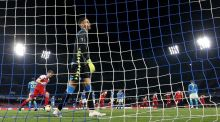 Napoli goalkeeper Alex Meret reacts after Arsenal's Alexandre Lacazette scores his goal. Photograph: Steven Paston/PA Wire