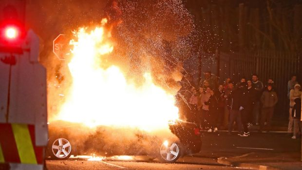 A hijacked car explodes after being set on fire during rioting in Derry last night. Photograph: PA