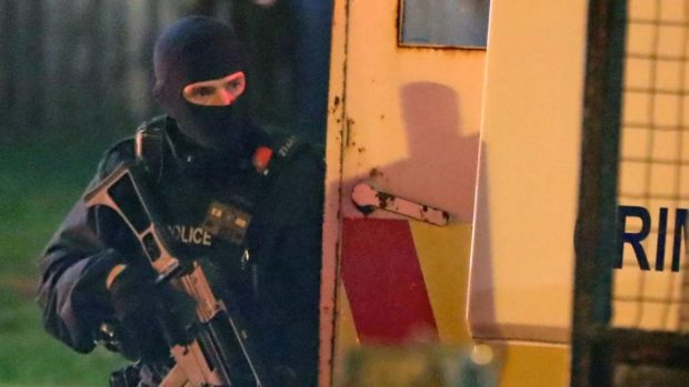 Armed police at the scene of unrest in Creggan, Derry, on Thursday. Photograph: Niall Carson/PA Wire