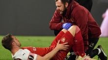A staff medic tends to Arsenal's Aaron Ramsey after he was injured during the UEFA Europa League quarter-final second leg against Napoli. Photo: Andreas Solaro/Getty Images