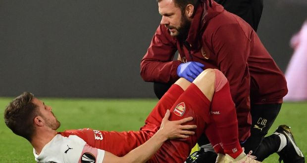 ea9a845f626 A staff medic tends to Arsenal s Aaron Ramsey after he was injured during  the UEFA Europa