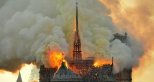 Notre Dame: flames and smoke billow from the roof of the Paris cathedral. Photograph: Thierry Mallet/AP
