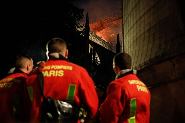 Notre Dame: firefighters at the Paris cathedral on Monday night. Photograph: Geoffroy van der Hasselt/AFP/Getty