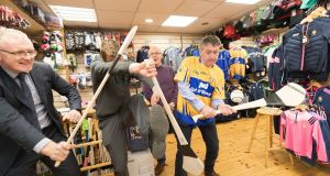 Billy Kelleher meets up with Clare hurling legends Brian Lohan and Niall Gilligan  while canvassing in Ennis, Co Clare, for the European elections. Photograph: Eamon Ward