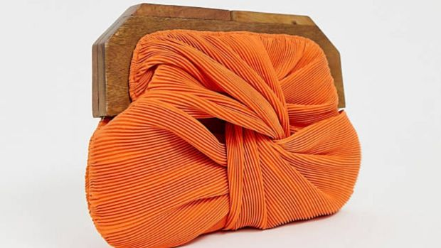 Orange pleated clutch Asos. €48.39