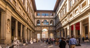 A flick through old guide books throws up the faded ticket of admission to the Uffizi Gallery in Florence and keepsakes such as a postcard from a visit to the Hermitage Museum in Leningrad. Photograph: Getty Images