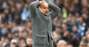 Manchester City manager Pep Guardiola reacts as he discovers  Raheem Sterling's late goal against Tottenham, that would have sealed his side's progress to the semi-final, was ruled out for offside.   Photograph: Martin Rickett/PA
