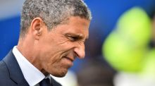 Chris Hughton: has five games to ensure Brighton maintain their Premier Division status this season. Photograph:  Glyn Kirk/AFP/Getty