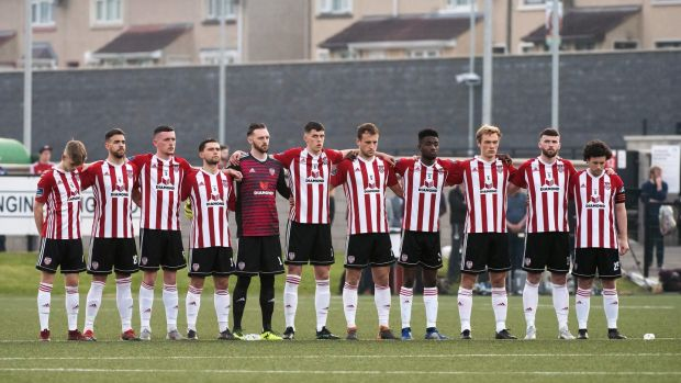 Derry City players during a minute's silence for journalist Lyra McKee who was shot dead in the city on Thursday night. Photograph: Evan Logan/Inpho