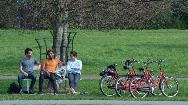 French tourists Bruno Jonathan, Julien Gossec and Nikias Ioannidis enjoy the sunshine in the Phoenix Park, Dublin, on Good Friday, the hottest day of the year so far. Photograph: Dave Meehan/The Irish Times