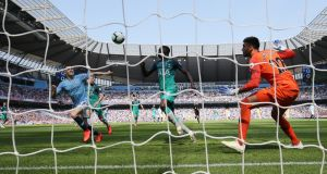 Manchester City's Phil Foden scores his early goal against Tottenham at the Etihad Stadium. Photograph: EPA