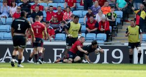 Saracens' Michael Rhodes scores a try despite the tackle from Andrew Conway of Munster. Photo: Billy Stickland/Inpho