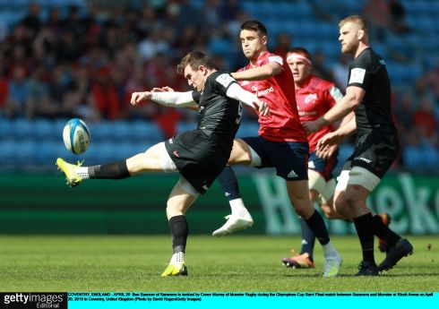 Ben Spencer of Saracens is tackled by Conor Murray. Photograph: David Rogers/Getty Images