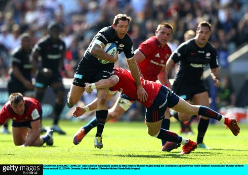 Alex Goode of Saracens is tackled by Mike Haley. Photo: Michael Steele/Getty Images