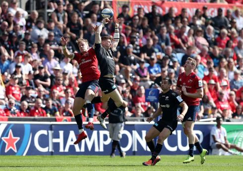 Munster's Mike Haley in action with Saracens' David Strettle. Photo: John Clifton/Reuters